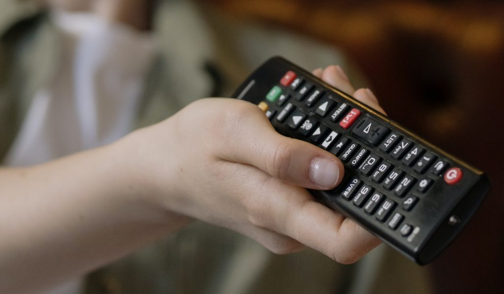 Person Holding Black Remote Control