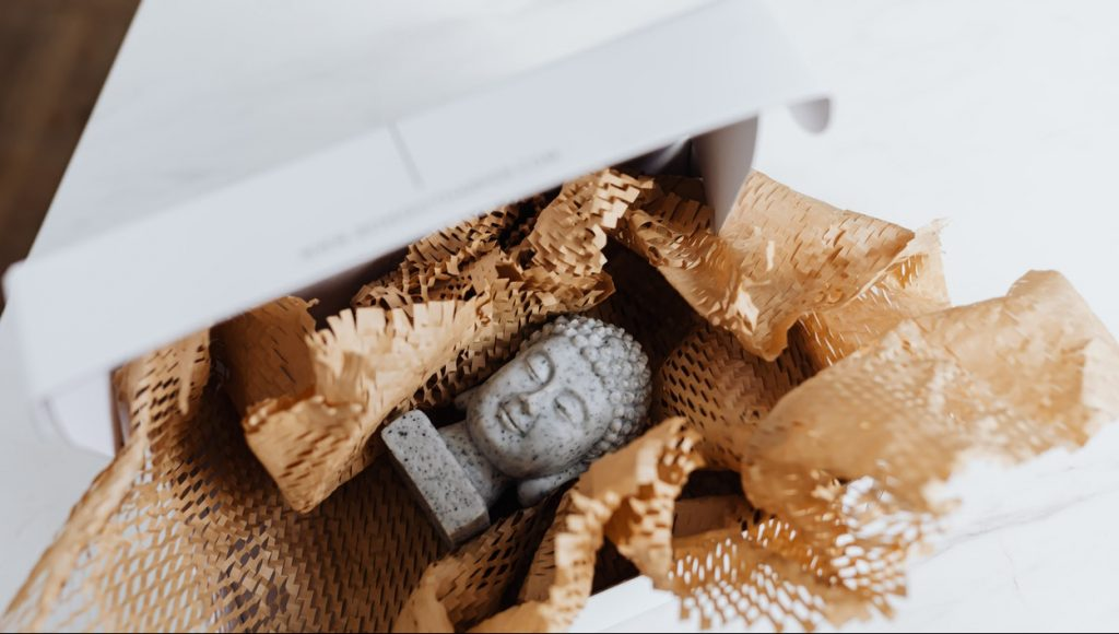 Granite Buddha bust in cardboard package