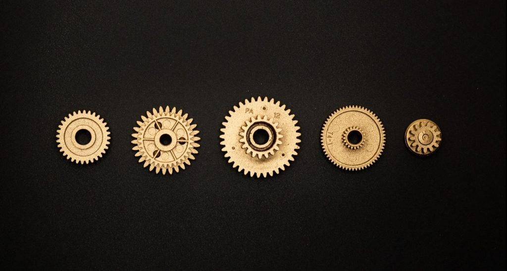 Golden Round Gears on Black Surface