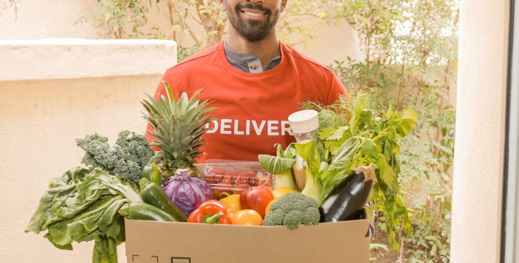 A Man ddelivers the Groceries in box